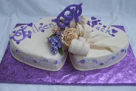 heart wedding cake purple heart wedding cake with gumpaste flowers and decorations
