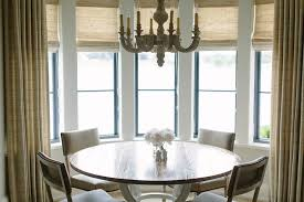 round dining table with gray dining chairs transitional dining