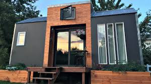 tiny house on wheels modern bright big windows small home design
