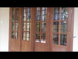 Wooden front window design Kerala Home