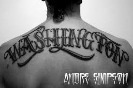amazing black washington lettering tattoo on upper back by andre
