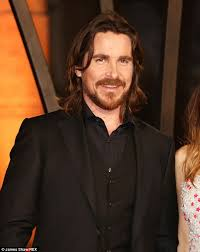 bale needs a hair cut christian bale displays his dishevelled hair as he arrives in la