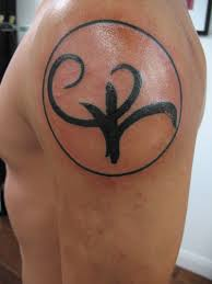 greek symbol for strength tattoo on left shoulder