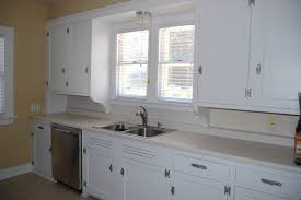 straight white kitchen cabinets with grey glaze metal appliances