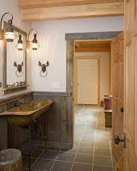 burlington rustic home interiors bathroom with dark tile floor