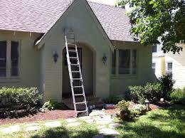 painting english tudor brick house outdoors back fence