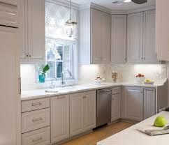 gray kitchen cabinets with white marble countertops pale gray kitchen cabinets with honed white marble