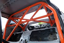 nissan 350z harness bar half cages in nissan z cars