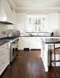 homey design kitchen backsplash white cabinets black countertop