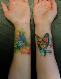butterflies tattoo on inside arms by klaim tattoomagz