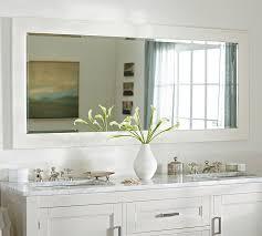 bathroom symmetrical arrangement of white pottery barn with vanity