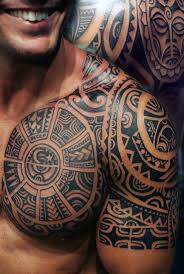 magnificent black ink aztec ornaments with lettering tattoo on
