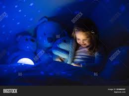 little reading book bed dark image u0026 photo bigstock