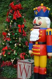 father christmas at epcot is part of the christmas decorations and