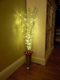 christmas sticks with lights diy easy christmas decoration for corners vase sticks spray paint
