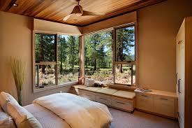 Bedroom Rustic - inspired minka fans in bedroom rustic with beautiful backyard