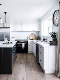 white kitchen with black island white farmhouse v groove kitchen with black island carrara marble