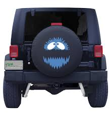 cartoon jeep wrangler character and cartoon tire covers
