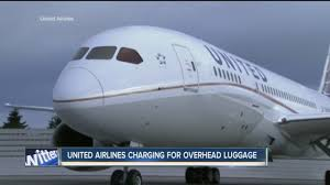 united airlines bag fee united airlines will charge extra fee for use of overhead bins