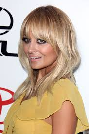 mid lengh hairstyles for over 50 with fringe below shoulder length hairstyles with bangsflattering haircuts for