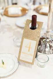 gold wine bottle table numbers invitations more photos table number on keepsake wine bottle