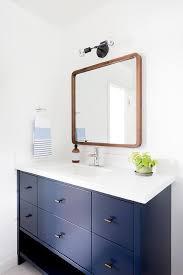 blue mid century modern bathroom with wooden mirror vintage