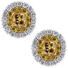 womens stud earrings yellow diamond oval stud earrings 14k white gold 0 87 ct