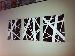 easy diy abstract art 3 different sized tape over white canvas