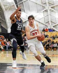 basketball player on bench sebastian much gives princeton boost off the bench in win over