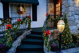 Christmas Window Garland Decorations by Christmas Porch Decorations Lighted Garland And Red Bows Create A