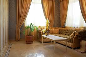 living room drapes with floor and curtain and orange sofa and