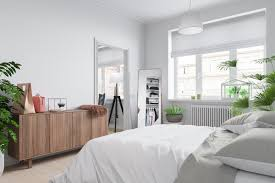 scandinavian bedroom scandinavian bedroom leaning mirror potted plants blinds wooden