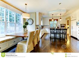 Kitchen And Dining Room White Large Luxury Modern Kitchen And Dining Table Royalty Free