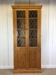 Shelves With Glass Doors by Rustic Elegance Upholstered Striped Armchair Elegant Dark Blue