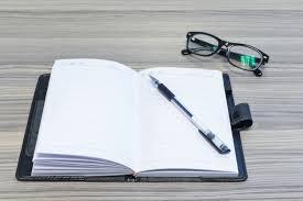 agenda sur bureau lunettes stylo et agenda ouvert sur le bureau télécharger des
