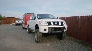 nissan titan build and price what tires do you guys recommend 05 titan offroad 4x4 nissan