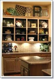 ideas for tops of kitchen cabinets china cabinet decorating ideas above the cabinet decor above