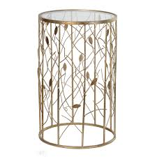 gold metal side table round gold metal side table with cut out branch and leaf design to