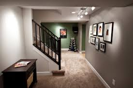 basement entry stair photo wall and home gym beyond