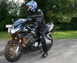 motorcycle riding pants file rider in black textile suit and blue helmet on honda cbr600