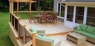 comfy outdoor dining room and living room at small backyard deck