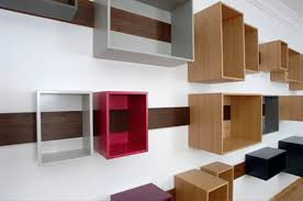 minimalist nice small wooden boxes on the white modern wall can