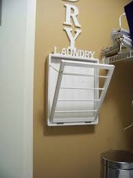 articles with wall mounted wooden expandable clothes drying rack