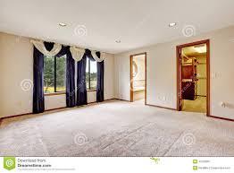 empty master bedroom interior with walk in closet and bathroom
