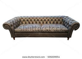 designers vintage brown chesterfield sofa against stock photo