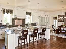 tile countertops kitchen island with stools lighting flooring
