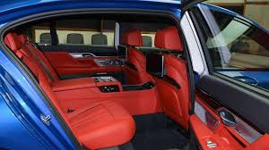 bmw red interior bmw m760li xdrive estoril blue with red interior stands out