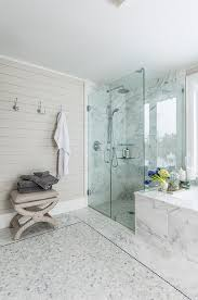 marble master bathroom with gray shiplap accent wall