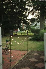 Tiki Patio Lights Tiki Torches And Solar Lights Border Patio Area Simple And Cheap