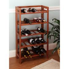 brown wooden rack with five shelves plus short legs placed on the